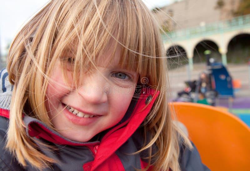 Campo de jogos da criança feliz fotografia de stock royalty free