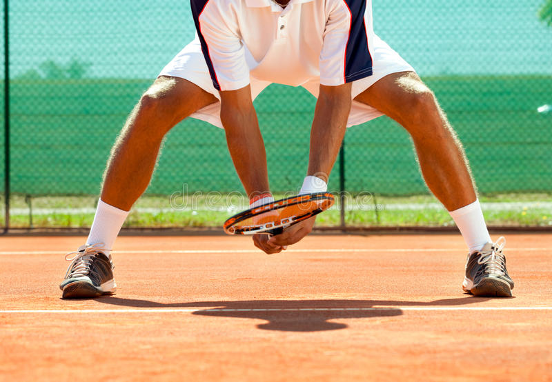 Campo de tenis del jugador y fotos de archivo
