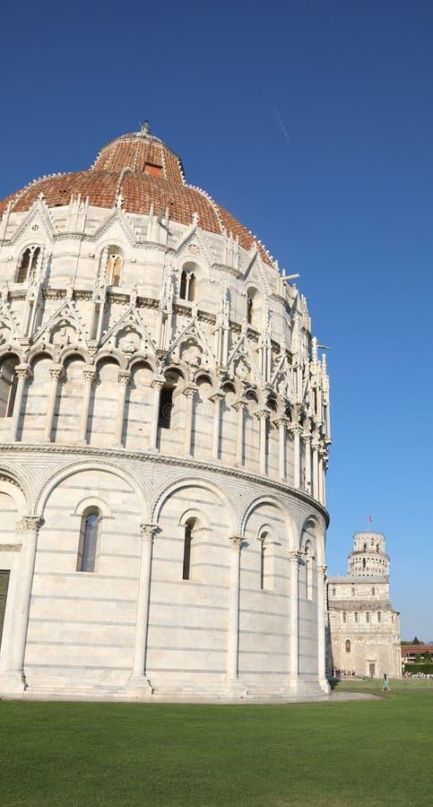 Campo dei Miracoli is the main square in Pisa with Baptistery an. Campo dei Miracoli is the main square in Pisa Italy with Baptistery and the famous leanign stock photo