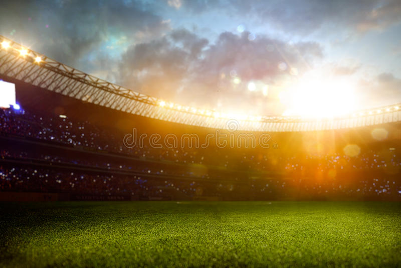 Campo di calcio dell'arena dello stadio di sera immagini stock