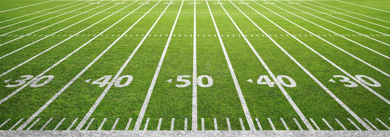 Campo e grama de futebol americano foto de stock