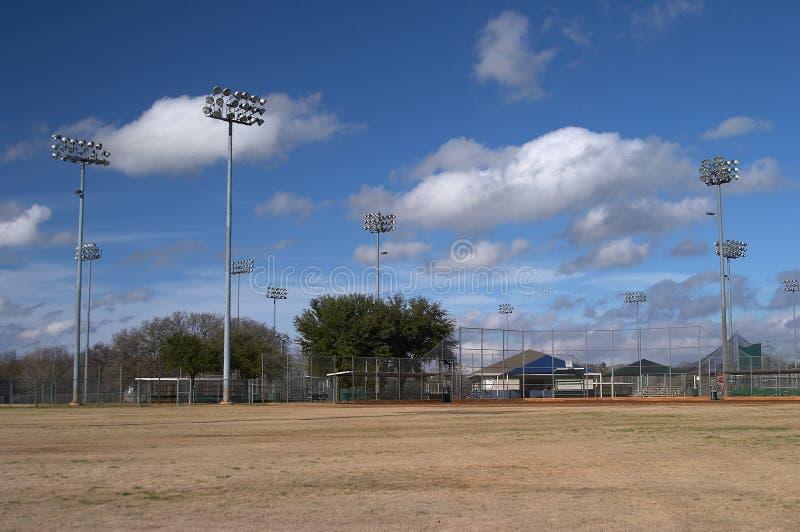 Campos de beísbol con pelota blanda fotografía de archivo libre de regalías