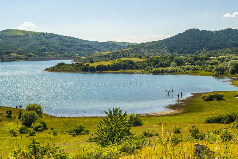 Campotosto Lake, in Abruzzi (Italy). Lake of Campotosto (L'Aquila, Abruzzi, Italy) at summer stock photography