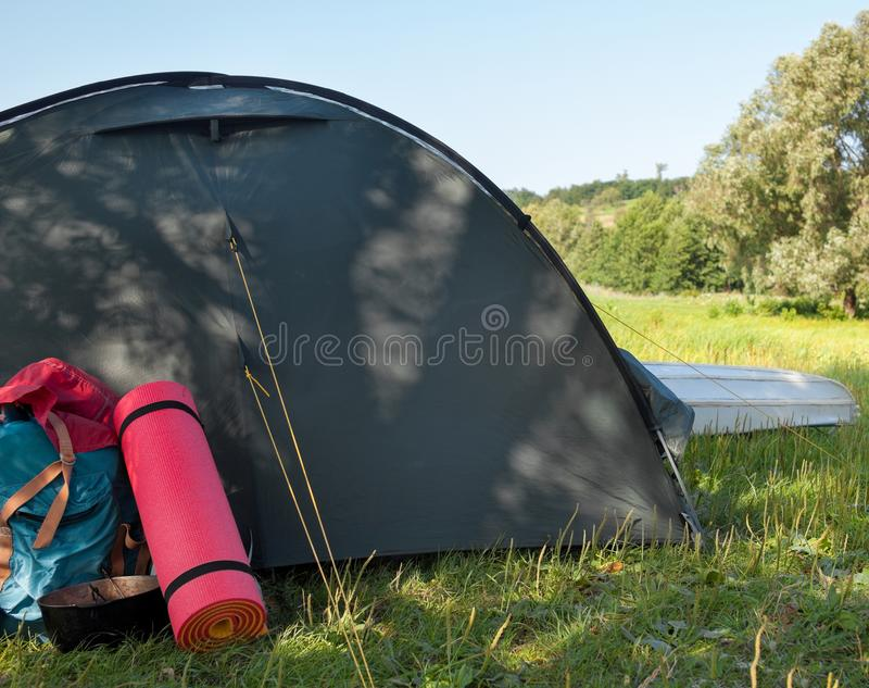 Campsite near the river royalty free stock photo