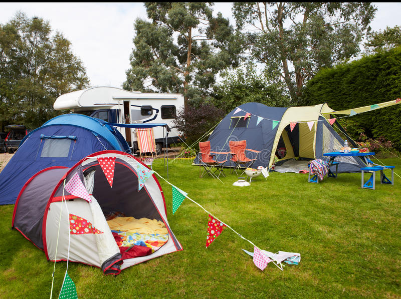 Campsite With Pitched Tents And Campervan stock image