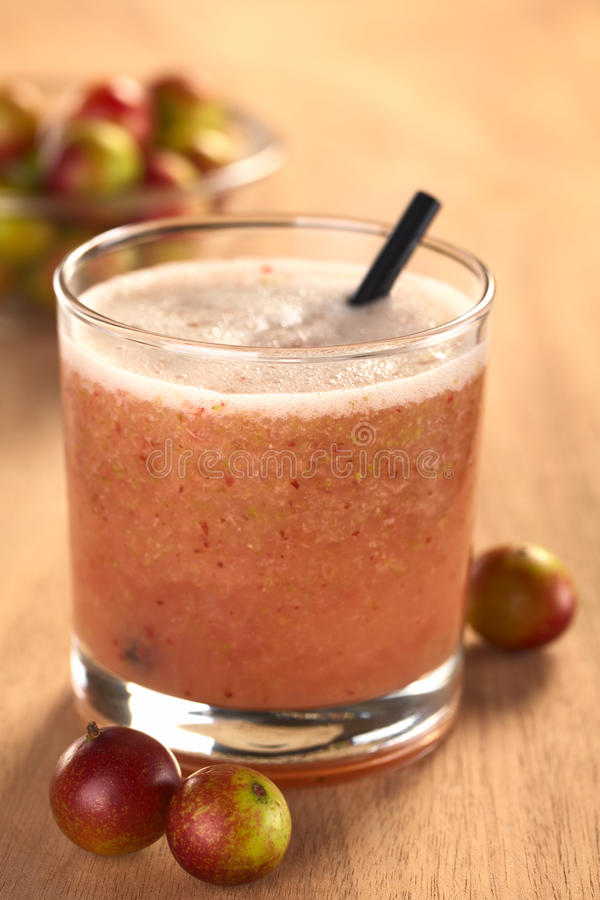 Camu Camu Berry Juice. Juice out of Camu camu berry fruits (lat. Myrciaria dubia) which are grown in the Amazon region and have a very high Vitamin C content ( royalty free stock photo