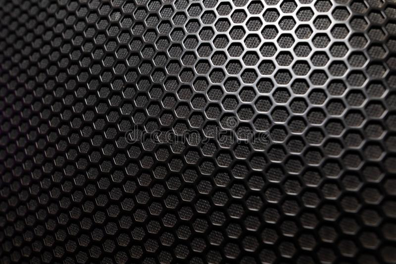 Musical powerful speaker with a protective grill close-up royalty free stock images