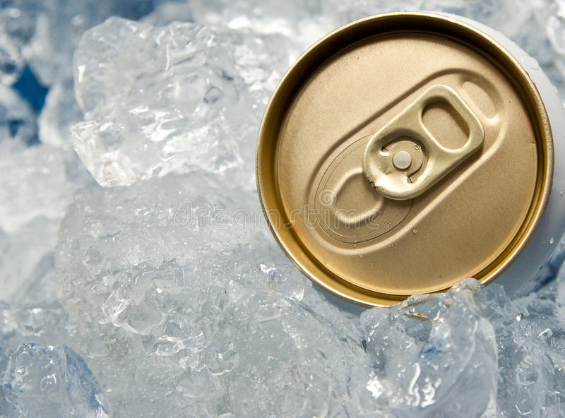 Can of beer in ice. The can of beer in ice stock image