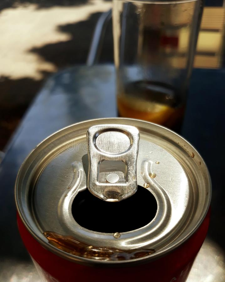Can of cola drink. Can of cola drink close up on a summer terrace stock photography