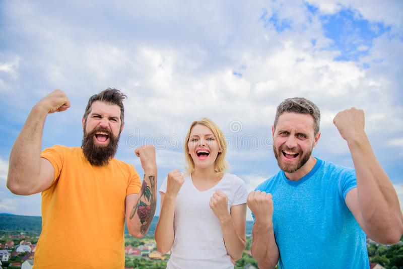 We can do it. Celebrate success. Ways to build successful team. Threesome stand happy with raised fists. Behaviors of royalty free stock image