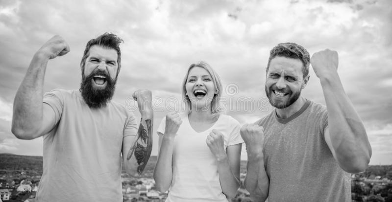 We can do it. Woman and men look successful celebrate victory sky background. Celebrate success. Ways to build. Successful team. Threesome stand happy with stock photography