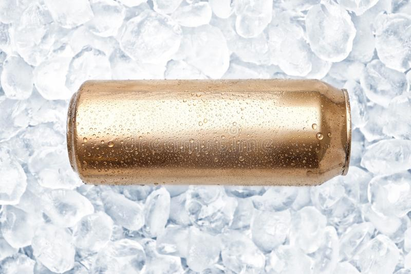Can of fresh beer. On ice stock photos