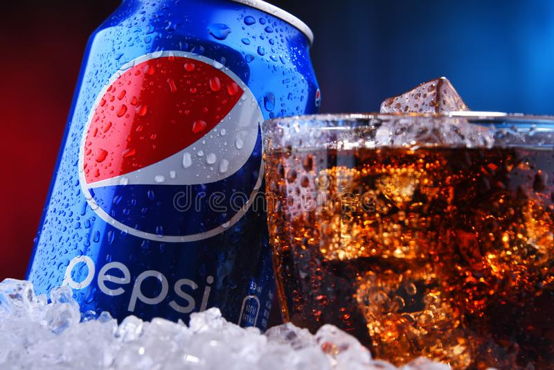 A can and a glass of Pepsi. POZNAN, POL - AUG 13, 2019: A can and a glass of Pepsi, a carbonated soft drink produced and manufactured by PepsiCo. The beverage stock photo