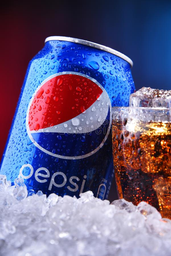 A can and a glass of Pepsi. POZNAN, POL - AUG 13, 2019: A can and a glass of Pepsi, a carbonated soft drink produced and manufactured by PepsiCo. The beverage royalty free stock images