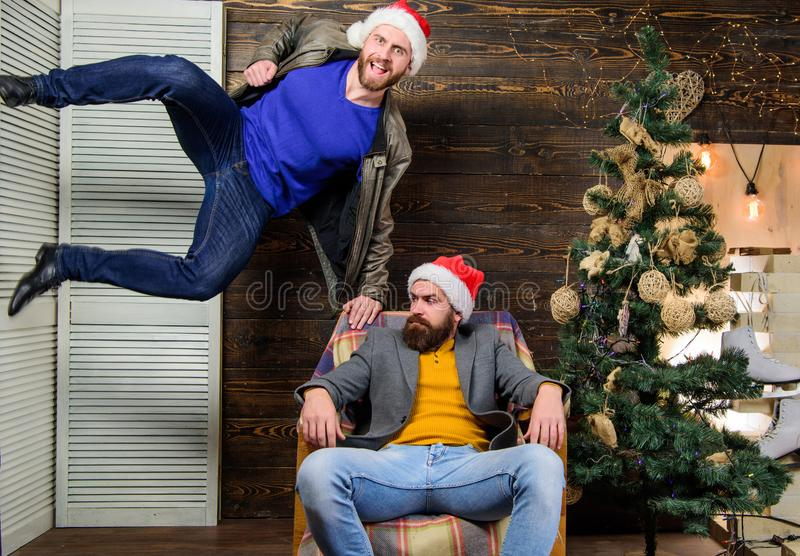 Can not hold back emotions. Emotional coup. Cant wait. Change point of view. Waiting for christmas. Cheerful men having. Fun near christmas tree. Christmas fun royalty free stock photography