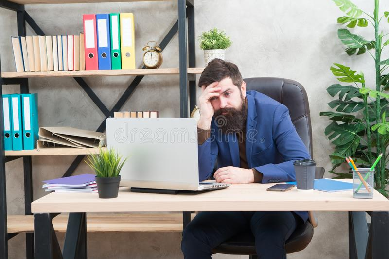 Can not remember his password. Man bearded boss sit office laptop. Manager solving business problems online. Business royalty free stock images
