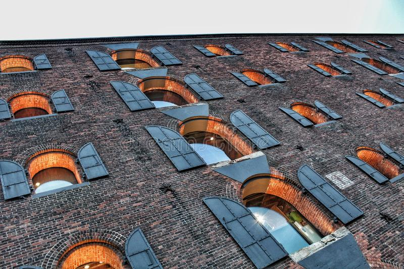 Even brickwalls let light in. We can observe a brick walled building in the DUMBO area, its windows as captivating breathing points in the midst of the stock photos
