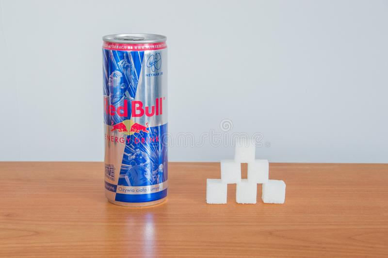 Can of Red Bull and six sugar cubes. Pruszcz Gdanski, Poland - February 28, 2018: Can of Red Bull and six sugar cubes royalty free stock images