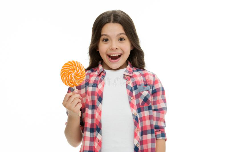Can sugar make us happy. Girl cute smiling face holds sweet lollipop. Sweets in appropriate portions ok. Girl likes. Sweets as lollipop candy isolated white royalty free stock photography