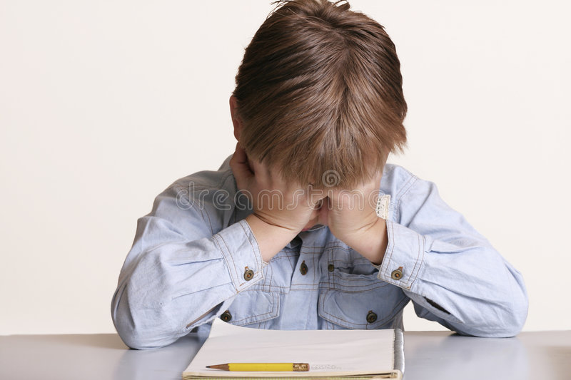 Can't do it. Young boy frustrated with school or with learning difficulties royalty free stock photos