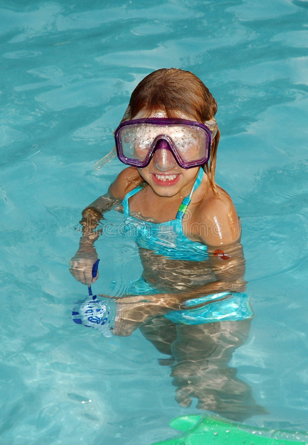Can't see where I am going!. Girl has fogged goggles in pool and can't see where she is going royalty free stock photography