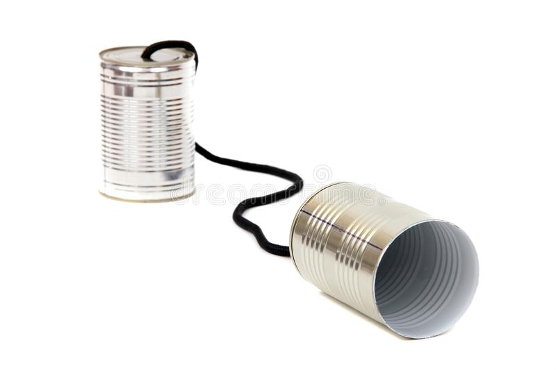 Can telephones. Concept of can telephones on white royalty free stock photos