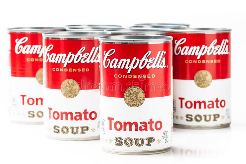 Can tins of Campbell`s brand tomato  soup. Can tins of Campbell`s brand tomato soup on white background royalty free stock images