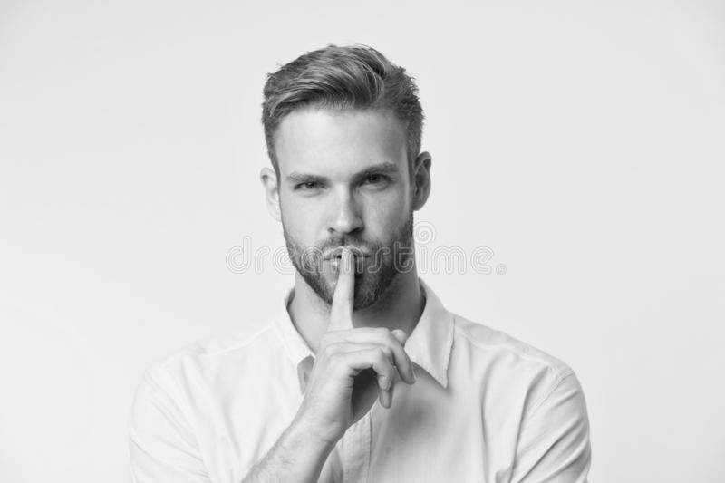 Can you keep secret. Handsome man keep index finger by his lips. Be silent. Secret story concept. Guy confident face. Just told his secret. Rumor legend and stock photo
