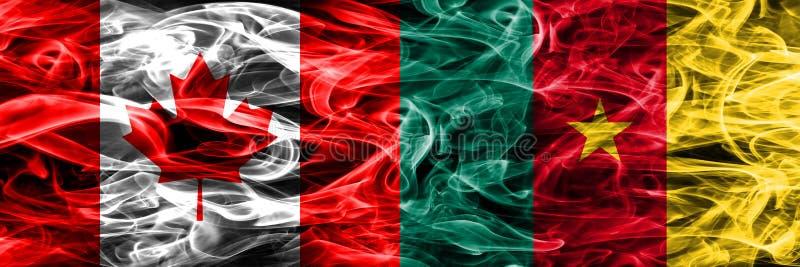 Canadá contra las banderas del humo del Camerún colocadas de lado a lado Canadiense y fotografía de archivo