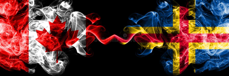 Canadá vs Aland smoky Mystic flags (Bandeiras místicas fumegantes) colocadas lado a lado Bandeiras de fumaça de seda, de cor espe fotografia de stock