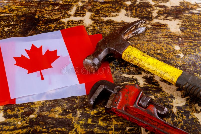 Canada canadian flag labor day hammer, wrench wooden background. Labor day concept. Canada happy labor day hammer, wrench a wooden background. Labor day concept royalty free stock images
