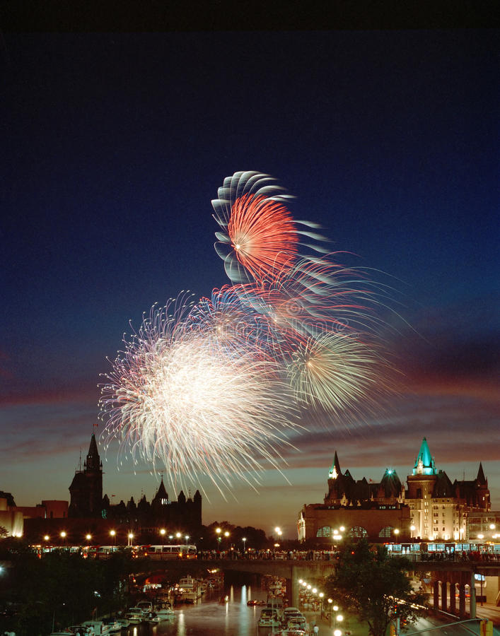 Canada Day Ottawa Ontario Fireworks. Canada Day fireworks over Ottawas capital hill and Rideau Canal. 6x7 Kodacolor drum scan royalty free stock image