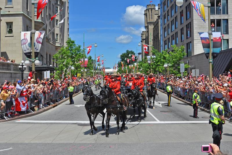 2011 Canada Day in Parliament Hill, Ottawa, Canada. OTTAWA, CANADA - JULY 1, 2011: RCMP riding on Sussex Drive on 2011 Canada Day in downtown Ottawa, Ontario stock image