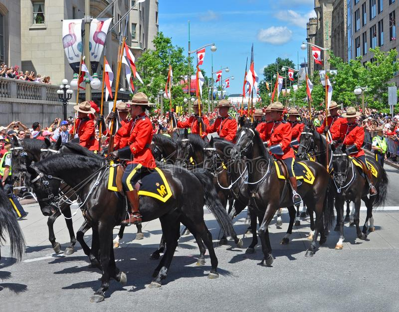 2011 Canada Day in Parliament Hill, Ottawa, Canada. OTTAWA, CANADA - JULY 1, 2011: RCMP riding on Sussex Drive on 2011 Canada Day in downtown Ottawa, Ontario stock photos
