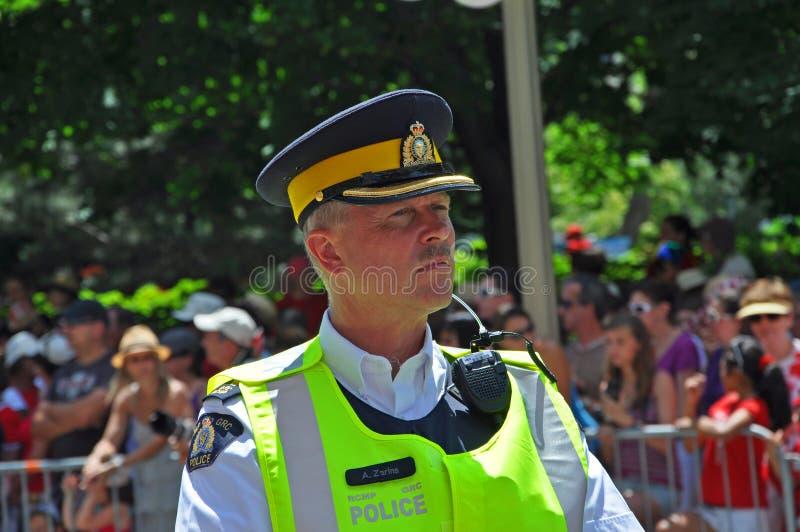2011 Canada Day in Parliament Hill, Ottawa, Canada. OTTAWA, CANADA - JULY 1, 2011: RCMP police on guard on Canada Day, Ottawa, Ontario, Canada stock photo