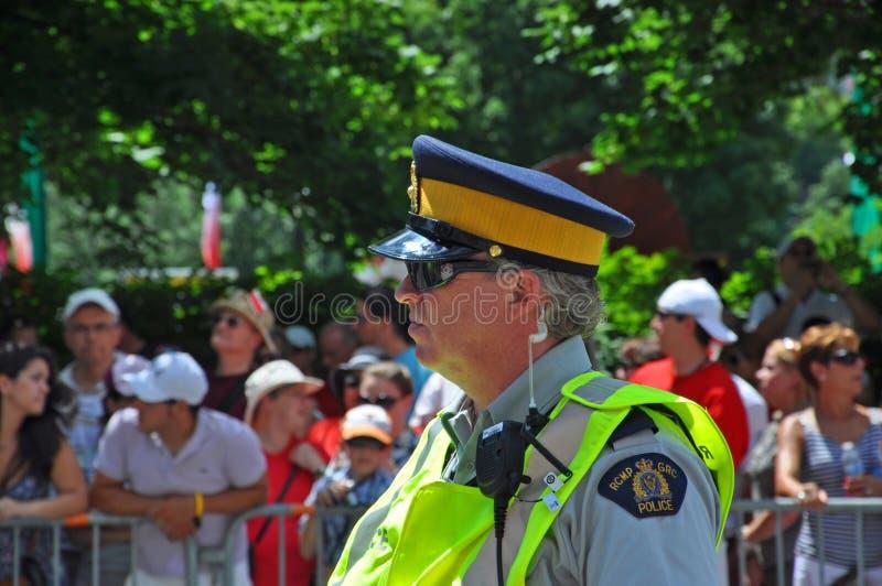 2011 Canada Day in Parliament Hill, Ottawa, Canada. OTTAWA, CANADA - JULY 1, 2011: RCMP police on guard on Canada Day, Ottawa, Ontario, Canada stock photos