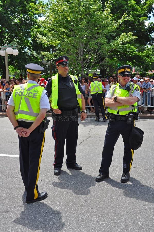 2011 Canada Day in Parliament Hill, Ottawa, Canada. OTTAWA, CANADA - JULY 1, 2011: RCMP police on guard on Canada Day, Ottawa, Ontario, Canada stock photography