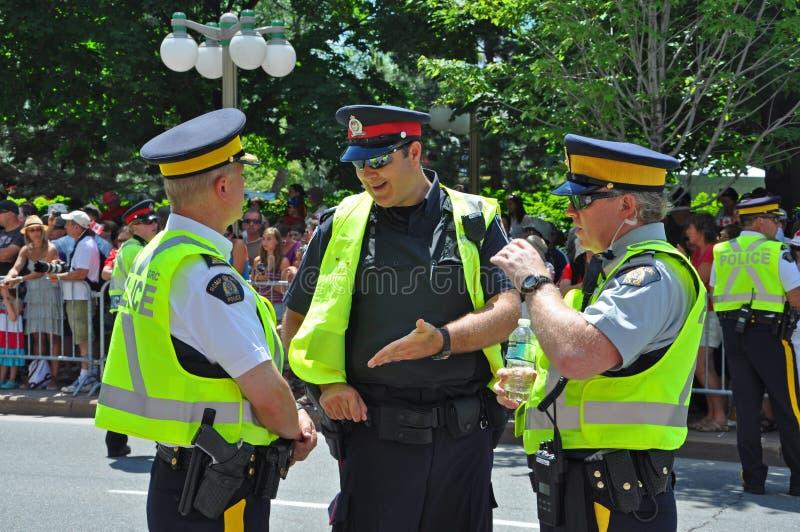 2011 Canada Day in Parliament Hill, Ottawa, Canada. OTTAWA, CANADA - JULY 1, 2011: RCMP police on guard on Canada Day, Ottawa, Ontario, Canada stock image
