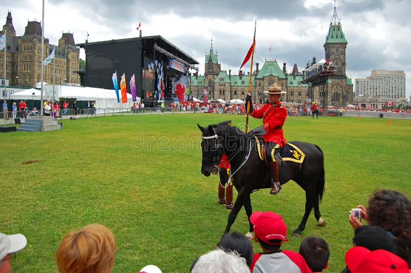 Canada Day RCMP riding horses in Ottawa, Canada. OTTAWA, CANADA - JULY 1, 2009: The Royal Canadian Mounted PoliceRCMP perform Musical Ride by Parliament stock photography