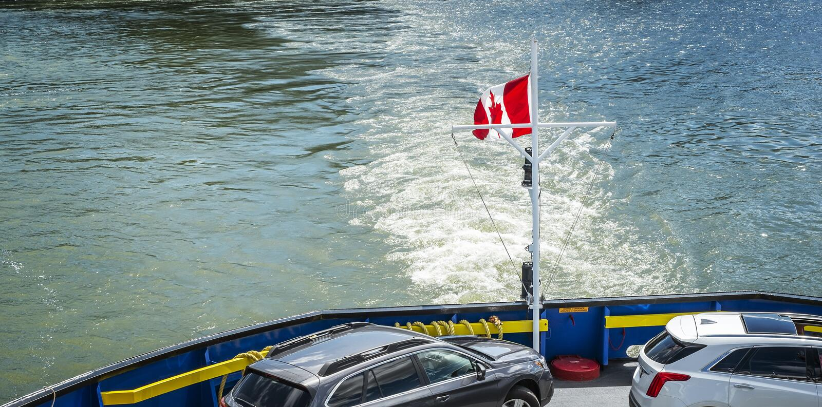 Canada flag on a ferry boat. Canada flag on the back of Quebec Levis ferry boat in the Saint Lawrence seaway, Quebec, Canada royalty free stock photography