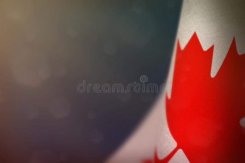Canada flag for honour of veterans day or memorial day. Glory to the Canada heroes of war concept on blue dark velvet background. Canada hanging flag for honour stock image