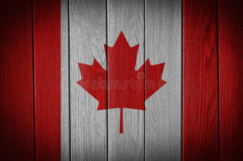 Canada Flag. Painted on old wood plank background