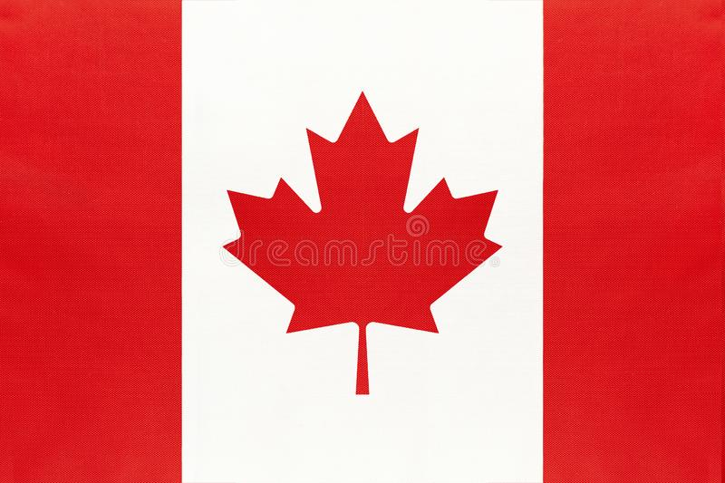 Canada national fabric flag, textile background. Symbol of international world north America country royalty free stock image