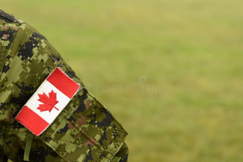 Canada patch flag on soldiers arm. Canadian troops royalty free stock photography