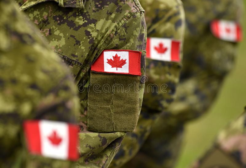 Canada patch flags on soldiers arm. Canadian troops.  royalty free stock photography