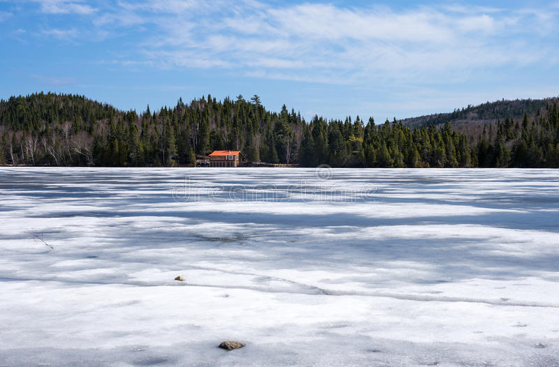 Canada. Quebec, Baie des Rochers, the still frozen lake royalty free stock photo