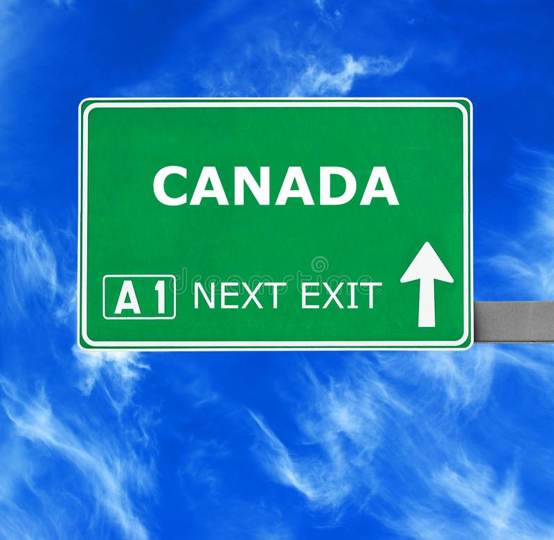 db3ecba137dbd CANADA Road Sign Against Clear Blue Sky Stock Photo - Image of guide ...