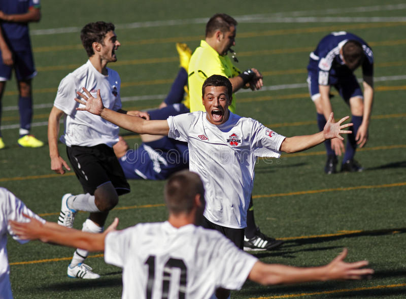 Canada soccer team celebration. Mark Eydelman (centre) of the Ajax Strikers from Ontario joins teammates in celebrating their 3-2 win over St-Hubert, Que., in stock photo