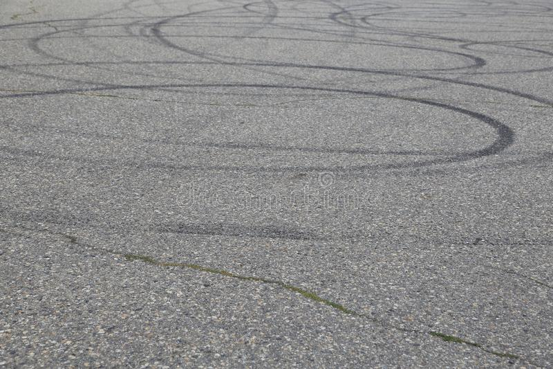 Skid marks-close up- I.C.B.C or police message for drunk driver warning for police stops royalty free stock photography