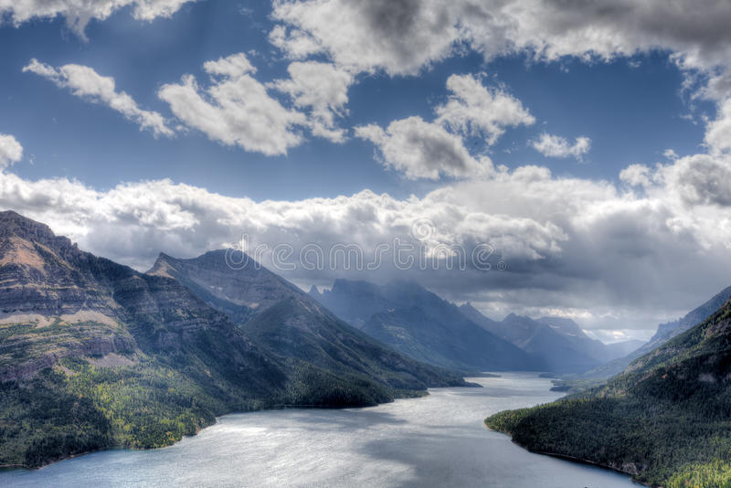 Canada-Waterton-Glacier-National-Park. This image was captured on a very dark, windy, and cold ay, from high above the lake. There were spectacular storm clouds royalty free stock photos